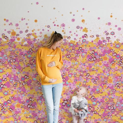 Papier-peint Champs de fleurs de printemps rose